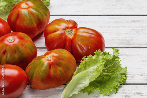 Plakát Red tomatoes and salad on white wooden board