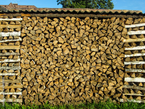 Woodpile with firewood texture background