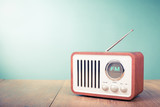 Fototapety Retro old radio front mint green background. Vintage style filtered photo
