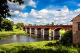 Fototapety Red brick bridge over river Aleksupe in Kuldiga city, Latvia