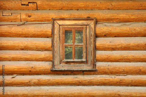 Background wall of wooden house with window