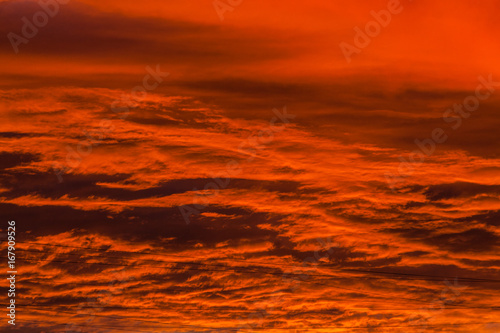 Fotobehang Rood Red voluminous clouds at sunrise