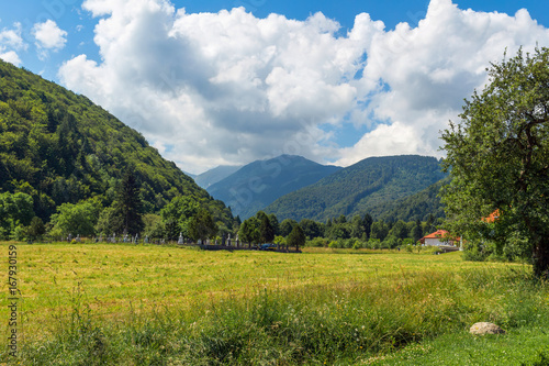 Scenery of Carpathian mountains, wild nature landscape in Sambata de Sus village, Romania