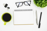 White office desk table with blank notebook page and supplies. Top view, flat lay. - 167930342
