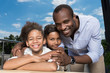 Quadro beautiful african-american family spending time outdoors
