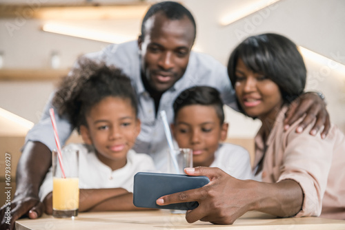 close-up shot of african-american family looking at phone
