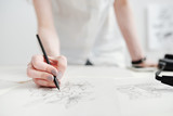 Female illustrator drawing sketches - 167942721