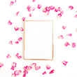 Photo frame mock up with space for text and pink rose petals on white background. Flat lay, top view. Valentine's minimal background.