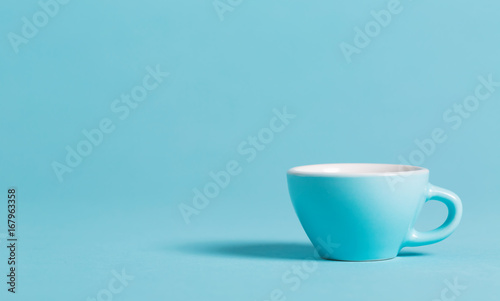 Little blue teacup on a bright background