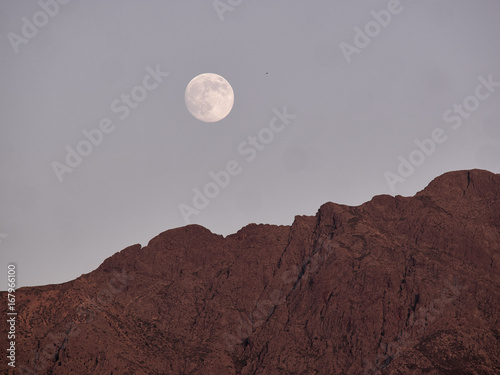 Full moon rises over the mountains of Lumio, Corsica