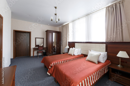 Hotel apartment, bedroom interior in the morning
