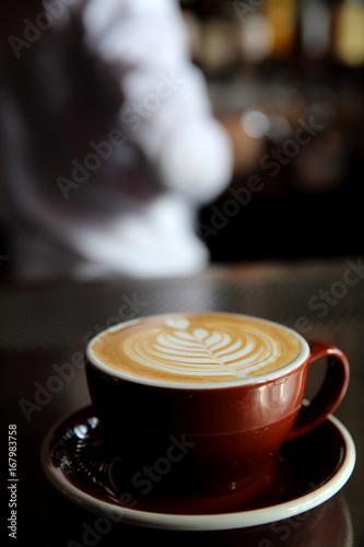 Cappuccino coffee on coffee bar in dark tone