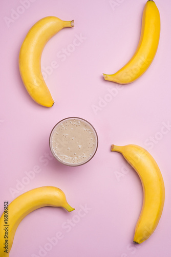 Top view. Group of bananas and banana smoothie on pink background. - 168016152