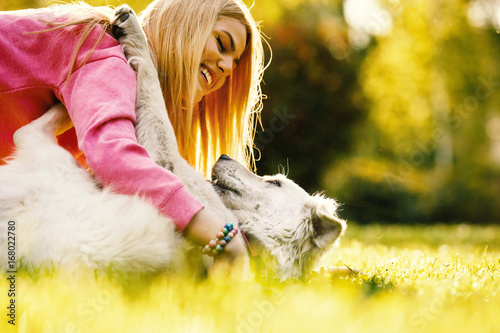 Woman is relaxing with dog