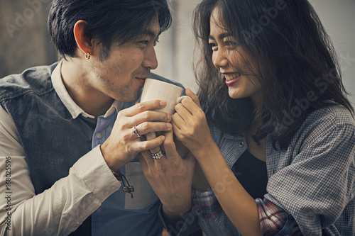 Sticker couples of asian younger man and woman happiness emotion with hot coffee cup in hand