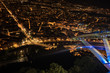 Quadro Panoramic view of Grenoble city illuminated at night and the cable car cabin's shadows