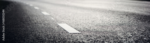 black asphalt road and white dividing lines - 168030344