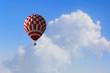 Aerostat floating in day sky. Mixed media . Mixed media
