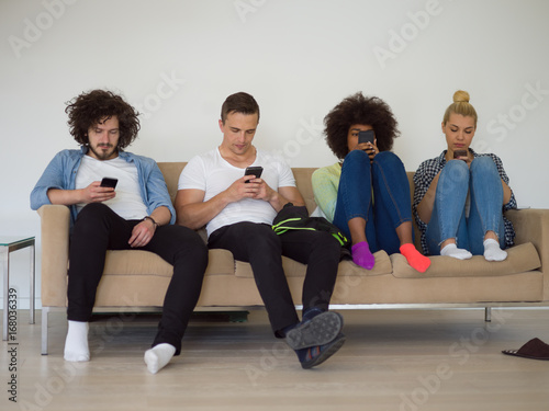 multiethnic group of young people staring at smartphone Poster