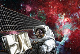 Astronaut on space mission. Elements of this image furnished by NASA. - 168068900