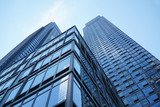 low angle view on modern office building with blue glass windows - 168071167
