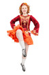Beautiful woman in red dress for Irish dance jumping isolated