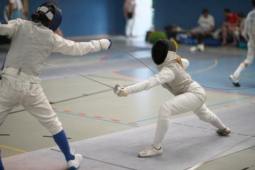 Girls fencing Foil at a tournament