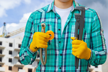 Plumber with tools and tube .