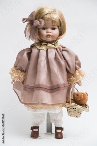 Plakat Ceramic porcelain handmade doll with blond hair and pink dress