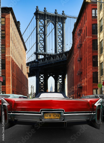 Retro old car red color on the road in New York - 168105799