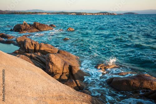 Foto Murales Rocky shore and a blue sea / Beautiful coast in Greece while sun rising