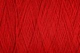 красная текстура из мотка толстых шерстяных ниток  - 168109997