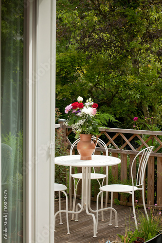 View to the Garden terrace with furniture and flowers