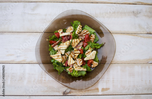Salad with tomato, meat, cucumber, lettuce and croutons. Healthy food. Fresh food. Tasty food - 168146963