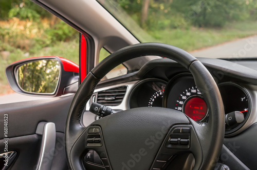 Foto op Canvas Snelle auto s Car interior with steering wheel and dashboard