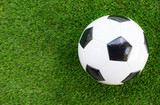 Soccer concept : Football (soccer ball)  on green grass background. Flat lay with copy space.