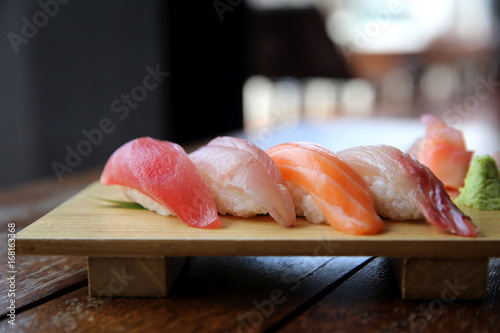 Mix sushi tuna salmon sea bass sushi on wood background japanese food Poster