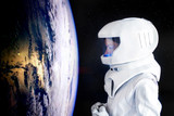 Astronaut looking at Earth from spaceExploration of outer space. Elements of this image furnished by NASA. - 168163784