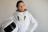 Female astronaut on a white background. Fantastic space suit. Exploration of outer space.