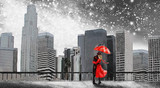 Fantasy illustration with Milky Way, stars. View of city space landscape. Painting New York. Skyscrapers and sky. Man and woman under an red umbrella