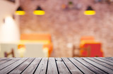 Wooden table top surface over blur kitchen cafe background - 168169122
