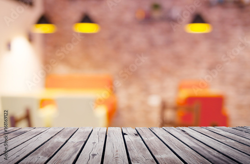 Wooden table top surface over blur kitchen cafe background