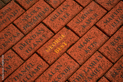 red brick with George bests name in front of old trafford stadium
