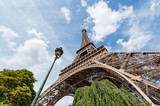 Eiffel tower and lamppost against blue sky in Paris, France
