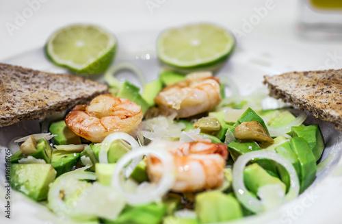 Salad of Avocado, fruit like butter, olive oil, onion, garlic, plate, prawn - 168188765
