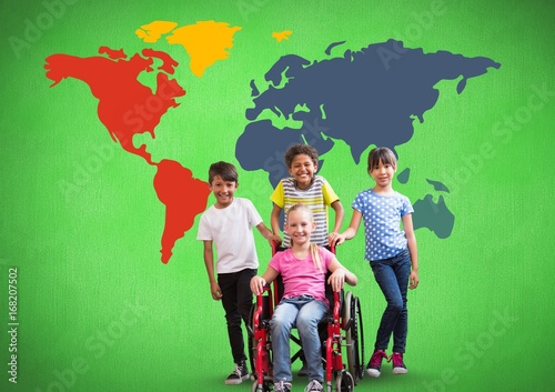 Disabled girl in wheelchair with friends in front of colorful world map