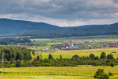 Foto op Canvas Pistache High angle view of fields and village among mountains