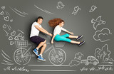 Biking to the future / Happy valentines love story concept of a romantic couple riding the bycicle  against chalk drawings background.  - 168211764
