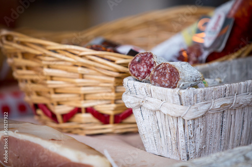 Traditional home-made salami in the basket on the market for sale. - 168217922