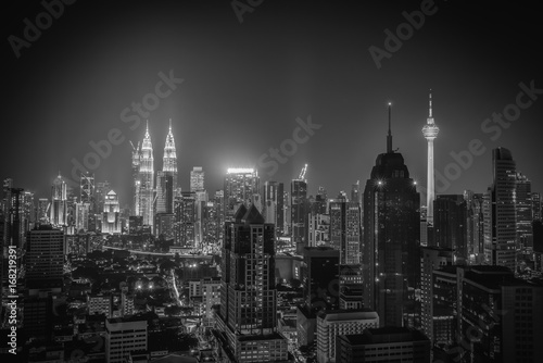 Black and white image of Kuala lumpur city skyline at night in Malaysia Poster